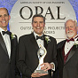 Rudy Bonaparte receives the 2016 OPAL Lifetime Achievement Award for Design. L-R: Tom Smith, ASCE Executive Director, Rudy Bonaparte, President and CEO of Geosyntec, Mark Woodson, ASCE President.